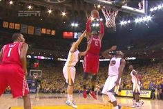 Dwight Howard powers for a two-handed jam like he's Shaq