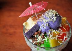 Filipino Halo-Halo   Is a popular Filipino dessert that is a mixture of shaved ice and evaporated milk to which are added various boiled sweet beans and fruits, and served in a tall glass or bowl.