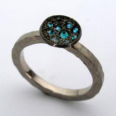 Todd Pownell, 950 Palladium ring with inverted blue diamonds.