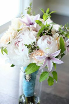 Clematis, peony, roses, carnations, mint. Purple, peach, cream white
