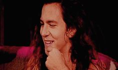Eddie Vedder is just too cute. SO much expression. Look at that smile. And the way his lip is put in motion by the touch of his finger. (Can watch this for hours...uh...well probably not.)