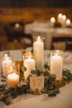 modern romantic candle wedding centerpiece / http://www.deerpearlflowers.com/wedding-ideas-using-candles/