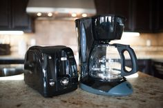Standard kitchen appliances with toasters and coffee maker.