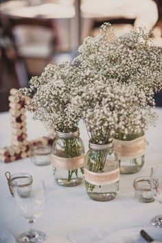 rustic baby's breath and mason jar wedding centerpiece / http://www.deerpearlflowers.com/rustic-wedding-details-and-ideas/