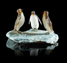 A Quartz and Multi Stone Penguin Family Carving, Peter Mueller, Brazil, consisting of three penguins congregating on an icy plain
