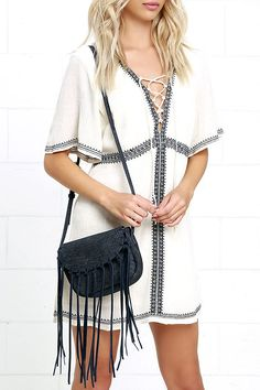 "The odds are always in your favor when you're toting around the Favorable Circumstances Navy Blue Fringe Purse! Tumbled faux leather shapes this cute cross-body purse with genuine suede fringe along the front flap. Fabric-lined interior has two side-wall pockets. Adjustable strap measures 48"" at longest adjustment."