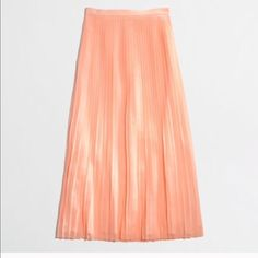 J crew pleated maxi skirt New never worn. Perfect condition. Peach/coral maxi skirt. I'm 5'5' and it sits on my feet. Perfect with flats. J. Crew Skirts