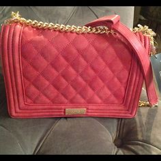New red Matt Quilted BCBG Paris with gold chain New with tags !! A beautiful Matt quilted purse by BCBG Paris . BCBG Bags Shoulder Bags