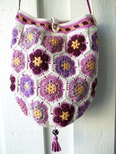 the Lancaster flower pattern as a bag, worked in purples  stitchesandpurls:    (via zlaika:cozybiscuit:Gorgeous!! Mia Inspiration Flickr)    (via cozybiscuit-deactivated20110523)