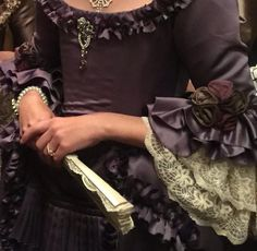 The ruching along the neckline is beautiful, I love the lace sleeve ruffles, and I always approve of bling!