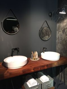 wood countertop that holds two bathroom sinks