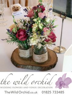 A trio of jam jars on a tranche of wood. Here the jars have been decorated with hessian and lace. Flowers in ivories, rich creams, dusky pinks, lavender and raspberry. Table Centerpieces, Wedding Centerpieces, Wedding Table, Rustic Wedding, Table Decorations, Flowers In Jars, Pink Flowers, Spring Wedding, Wedding Day