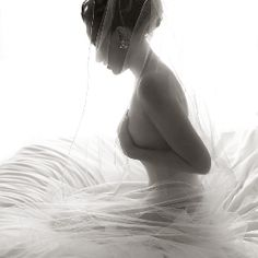 Breathtaking bride wrapped in her veil moments before stepping into her gown.  (Image: Hello Gorgeous Photography)