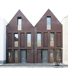 Zeeuws Housing complex by Pasel.Kuenzel Architects - Rotterdam, Netherlands.  Cool fusion of contemporary with old brick row houses.  Comprises many 34 units total.