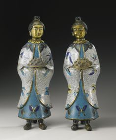 A RARE AND UNUSUAL PAIR OF CLOISONNE FIGURES OF FEMALE ATTENDANTS QING DYNASTY, 19TH CENTURY
