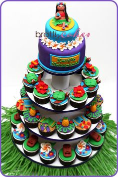 36 cupcakes & 2 tier mini cake for a first bday party! Hawaiian Cupcakes, Luau Cupcakes, Hawaiian Desserts, Wedding Cupcakes, Cupcake Cakes, Hawaiian Theme, Purple Wedding Cakes, Wedding Cakes With Flowers, Flower Cakes
