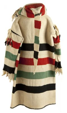 Métis Capote was a knee-length wool jacket with a hood. It was made out of a single Hudson's Bay Blanket, and was commonly tied around the waist with a Métis sash. Native American Fashion, Native American Art, American Indians, Capote Coat, Hudson Bay Blanket, Blanket Coat, Fur Trade, Period Outfit, Mountain Man