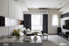 53 坪的住宅空間,設計師給予公領域開放規劃,透過線條的沉穩律動闡述視覺層次,並加入石、木、鍍鈦等材質潤色空間,搭配光影效果,傳遞空間多變的生活面向,快跟著小編一起走進來看看吧!一走進玄關,可見牆面飾以鏡面與燈光,加入俐落的線條妝點,凸顯簡約生活哲學;客廳融入純淨的木色與陽剛的石色,配合造型簡潔的家
