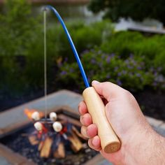 This is too cool! A campfire fishing rod for cooking. I want one!