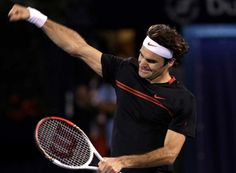 Roger Federer of Switzerland celebrates after defeating Andy Murray of Britain in the men's singles final at the Emirates Dubai ATP Tennis Championships in Dubai, United Arab Emirates, Saturday, March 3, 2012. Photo: Hassan Ammar / AP