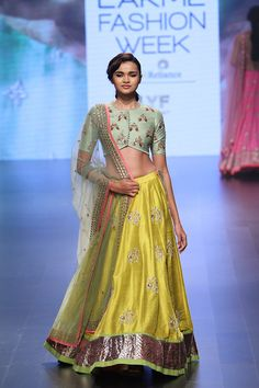 Buy Muffins Yellow Raw Silk Embroidered A-line Lehenga online in India at best price. Yellow Row Silk a-line lehenga Blouse Work : Embroidery Lehenga Work : Embellished Occasion : Festiv Lakme Fashion Week, India Fashion, Ethnic Fashion, Asian Fashion, Women's Fashion, Fashion Design, Indian Look, Indian Ethnic Wear, Indian Style