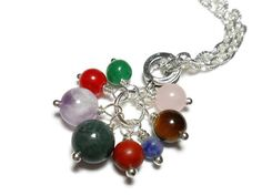 """Positive Energy Necklace Healing Crystal by ETSY CrystalEnergyCanada. Positive energy necklace made with genuine stones. This is a cluster style pendant with 8 different crystals. Each stone is individually wired into a charm, then attached to a European-style bail. The pendant comes with an 18"""" silver-plated chain with textured detail. The stones used in this pendant incude: amethyst, sodalite, rose quartz, moss agate, green aventurine, red agate, red jasper and tiger eye. The sizes of the…"""