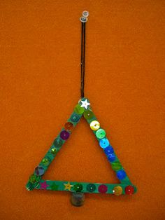 Use Your Coloured Pencils: Christmas trees. Icy pole sticks and sequins. Macrame bead as trunk