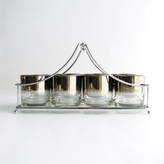 Love this set of vintage cocktail glasses with tray.  Very Mad Men.  Need to search for a set.