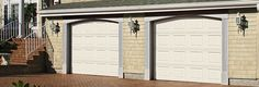 This picture reminds me of my first house. When I purchased the house, it had a completely different style of garage door. Fortunately, with a little online research, I was able to get the right door and the right installers.