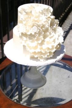 We didn't get to meet the bride until two days before the wedding when she came to choose her flavors (almond cake with coconut filling and NYC honey icing).  Luckily, when she hired us, she was super clear with the direction of the design of her wedding cake - lots of ruffles!  We were able to get to work making a hundred individual petals to complete this sugar garden rose wedding cake.  By Sugar Flower Cake Shop.