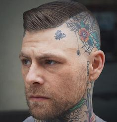 side shaved haircut with head tattoo