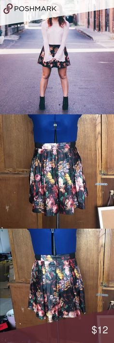 Skater skirt Floral pleather skater skirt with elastic bands on the sides and an invisible zipper in the back. The zipper is in good working order. The skirt is in like new condition. Rue 21 Skirts Circle & Skater