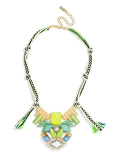 This intergalactic masterpiece is embellished with cool neon stones and mirrored gems, and tied around the neck with graphic-printed ribbons and sporty cords.
