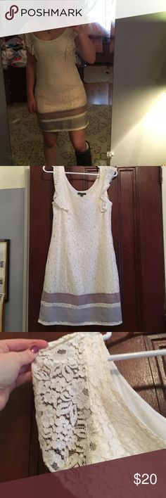 White lace dress This is a gorgeous white lace dress. It has a flowy feel and feature small cute lace sleeves. It has stripes at the bottom that adds a bit of flare American Eagle Outfitters Dresses