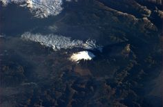 "Astronaut Tom Marshburn captured this captivating image of Mt. Fuji from the International Space Station on 3-13-13. In his words: ""Day ended with a surprise view of Mt. Fuji in the morning."""