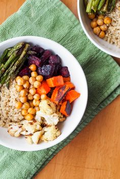Quinoa Power Bowls with Roasted Veggies and Avocado Sauce are made with oven roasted beets, sweet potatoes, cauliflower, asparagus and pan toasted chickpeas, served over a fluffy bed of quinoa and drizzled with a creamy and flavorful avocado dressing. The ultimate feel good meal. Gluten Free & Vegan. | avocadopesto.com