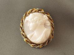 10K Yellow Gold Seed Pearl Hand Carved Left Facing Pink Cameo Brooch Pendant  $330.00