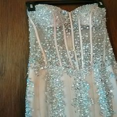4aa1ee1d4ce Gown Beautiful beaded prom gown. Strapless. Champagne color. Worn once.  Some slight