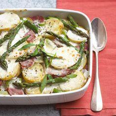 Potato-Ham Bake Asparagus and tarragon give this modern bake recipe a touch of showmanship.