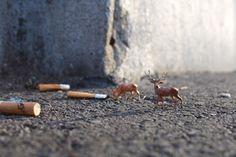 London, UK Artist Slinkachu ___ says a lot about smoking...