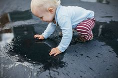 Stock photo of Toddler Boy Smiles While Playing in A Puddle With HIs Hands by Amandavoelker Blue Rain, His Hands, Toddler Boys, Little Boys, Play, Toddlers, Baby Boy, Baby Boys, Infant Boys