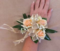 Peach spray rose corsage
