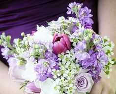 Here is the wax flower with lavender stock and roses.  Tulips will be a higher price point.  reception wedding flowers,  wedding decor, wedding flower centerpiece, wedding flower arrangement, add pic source on comment and we will update it. www.myfloweraffair.com can create this beautiful wedding flower look.