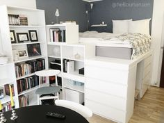 The platform bed made out of IKEA furniture. Two MALM dressers, 5 small BILLY bookcases, two BESTÅ bookcases + wooden plates and battens painted white.