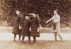 Queen Victoria's grandchildren Prince Alfred playing with his sisters Princesses Marie, Victoria Melita and Alexandra of Edinburgh