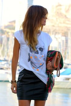 Graphic tee and leather skirt.