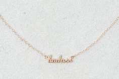 Kris Nations Script Charm Necklace by  American Eagle Outfitters | Kris Nations celebrates equal parts sophistication and boho-inspired style, with a dose of vintage inspiration for jewelry and accessories you can take anywhere. Shop the Kris Nations Script Charm Necklace and check out more at AE.com.