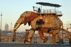 The Sultan's Elephant was a show created by the Royal de Luxe theatre company, involving a huge moving mechanical elephant, a giant marionette of a girl and other associated public art installations. The show was commissioned to commemorate the centenary of Jules Verne's death, by the two French cities of Nantes and Amiens, funded by a special grant from the French Ministry of Culture and Communication. The show was performed at various locations around the world between 2005 and 2006.  The…