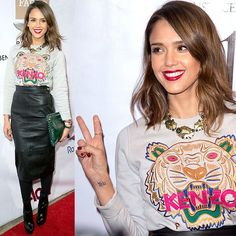 86b7159be50 Jessica Alba opted for the street-style-favorite Kenzo tiger sweatshirt and  paired it with an almost mumsy high-waisted