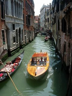 Venice wooden boat tours the city...
